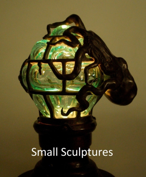 Globe lamp with octopus, bronze and glass